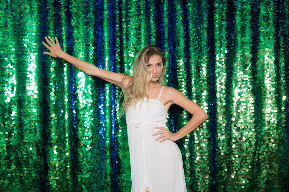 Custom backdrop with green sequins in our photo booth
