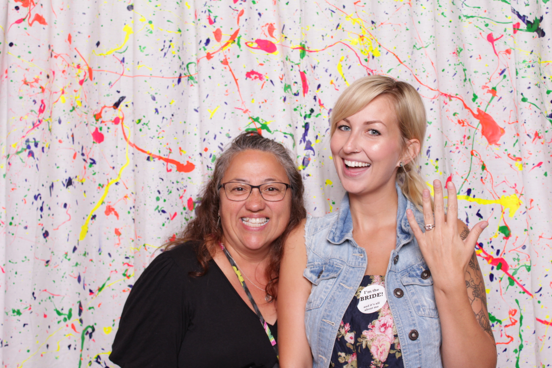 photo booth with custom paint splatter backdrop