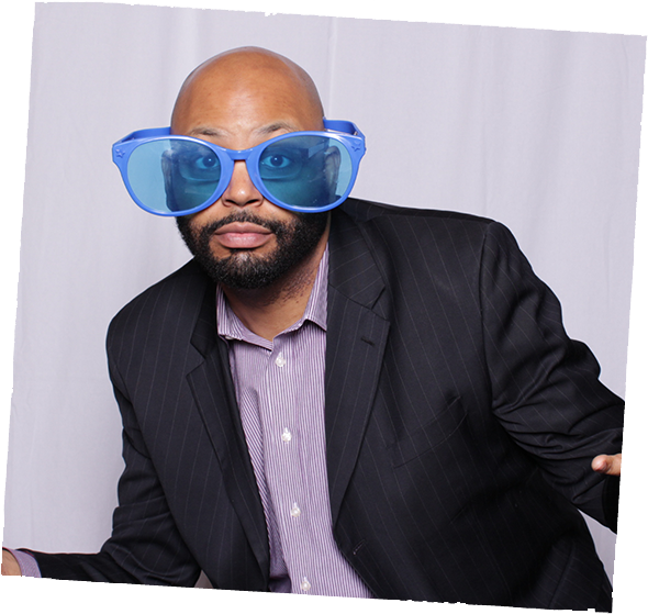 Party guest with blue glasses in photo booth