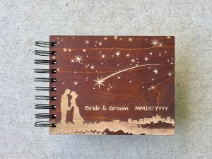 Hand Carved photo booth album with couple kissing on the cover
